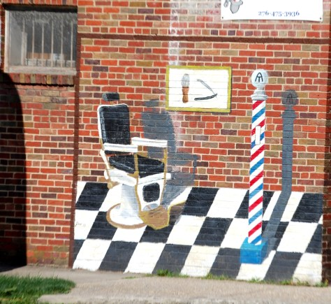 A barber shop mural with the Appalachian Trail logo