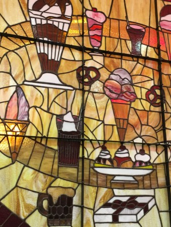 Lots of stained glass artwork and other art around the store