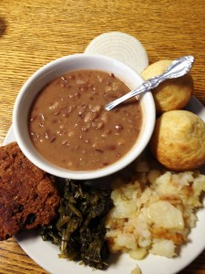 Salmon Patty Dinner with homemade cornbread, greens, fried potatoes and Past Times' famous soup beans
