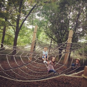 The kids got all tangled up in this giant spider web at Arbor Day Farm (by Marissa Noe)