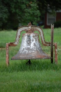 An old bell in someone's yard