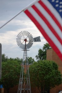 Kregel ELI Windmill framed by a flag on 9/11 in Nebraska City, Nebraska