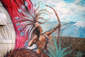 Closeup of an Aztec shooting an arrow