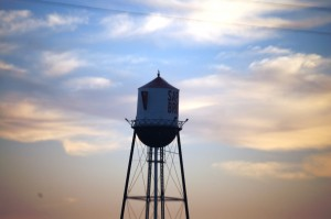 Sunrise colors behind the Sapp Brothers Coffee Pot Water Tower in Nebraska City, NE