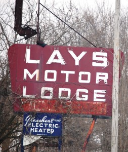 Lays Motor Lodge sign in Kingdom City, Missouri.  Motel building is dilapidated, but the sign remains
