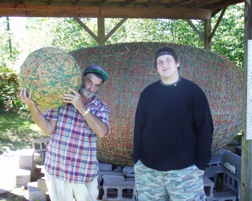 "Solomon hanging with James Frank Kotera ""JFK"" the Twine Ball Man in Lake Nebagamon, WI.  Largest Twine Ball in the World. Sept 2007"