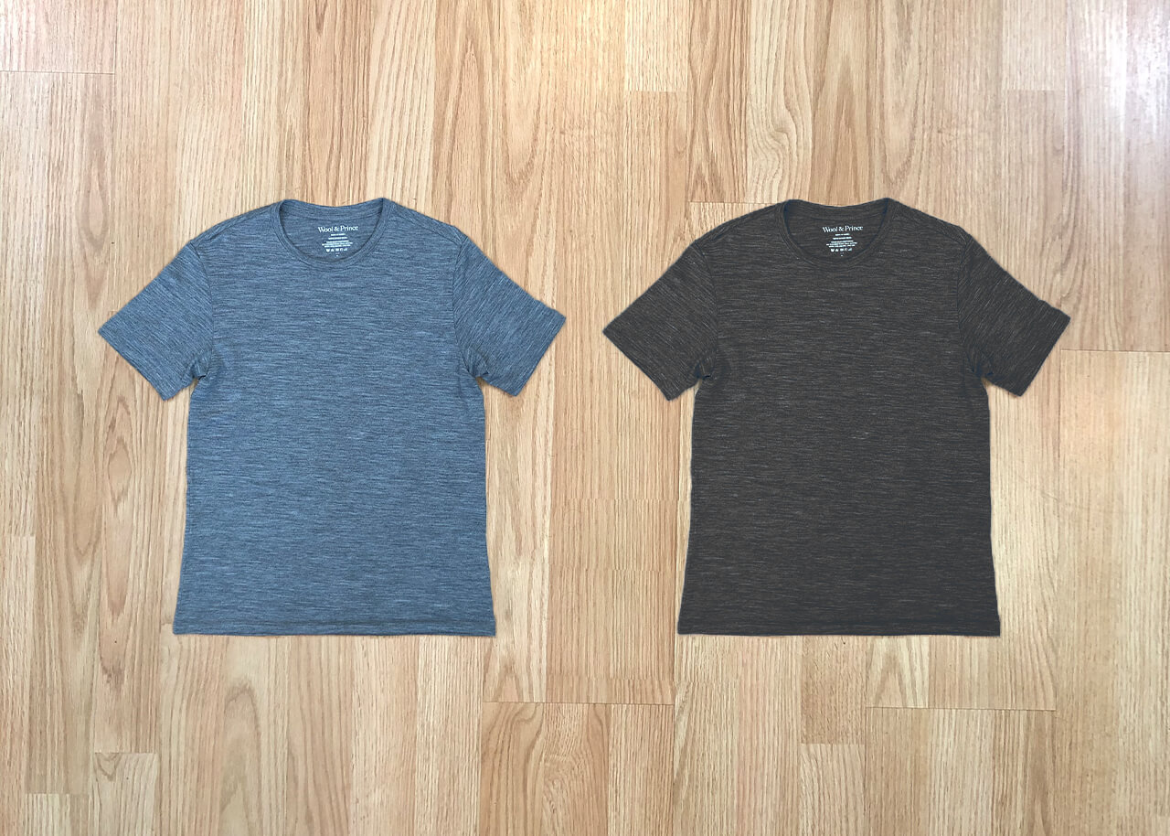 two shirts laid out flat on the floor