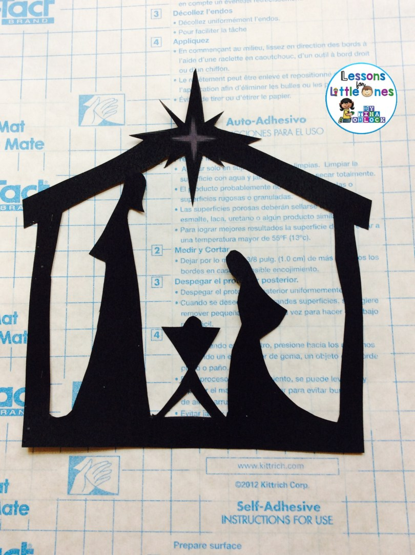 how to create a Christmas silhouette window decoration