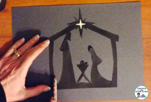 tracing Christmas window silhouette onto black construction paper