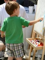 paint letters of the alphabet on an easel