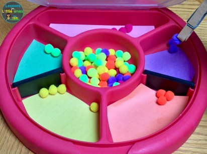 color sorting activity with pom poms & clothespin