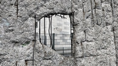 A hole struck through the Berlin wall outside the Topography of Terrors museum, Berlin, Germany, 2016.
