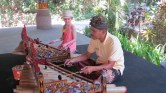 Taylor trying her hand at some Balinese music