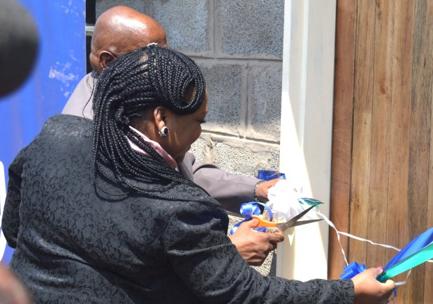 SLB Haed of Marketing front cuts the ribbon to the new with Minister of Social Development Molahlehli Letlotlo