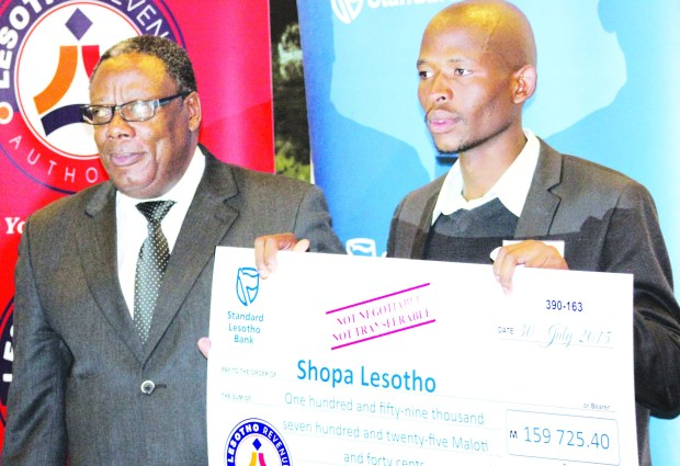 Lebohang Handy receives a cheque from Minister of Small Business Cooperatives and Marketing Thabiso Litsiba during the Bacha Entrepreneurship Project awards in July