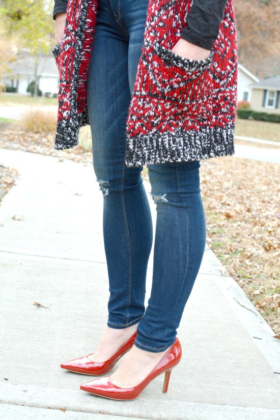 Ashley from LSR in a long cardigan and red pumps