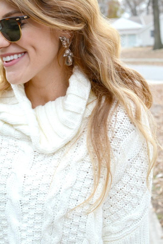 Ashley from LSR in an ivory cable knit sweater