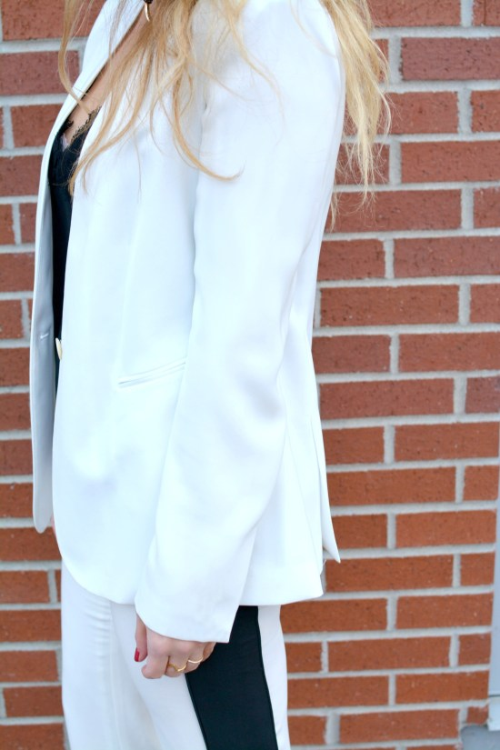 Ashley fro LSR in a white suit and lace camisole
