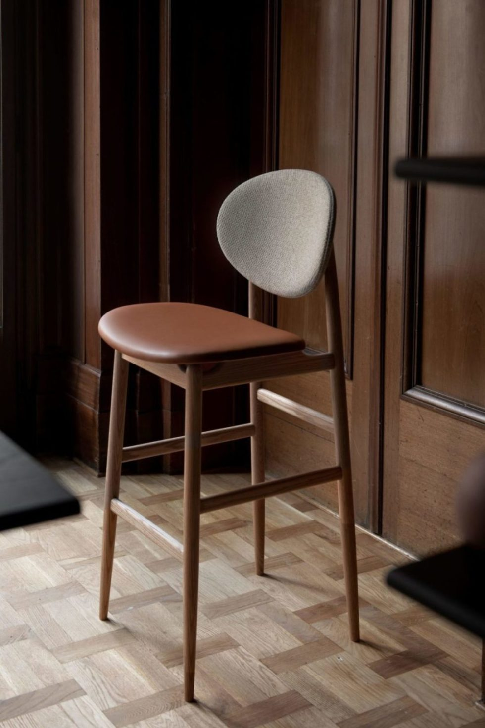 leather and fabric outline chair