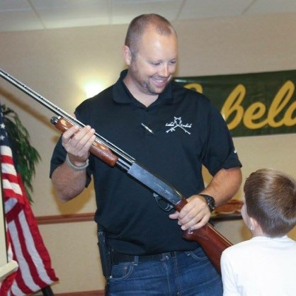 Explaining how a pump action shotgun works.