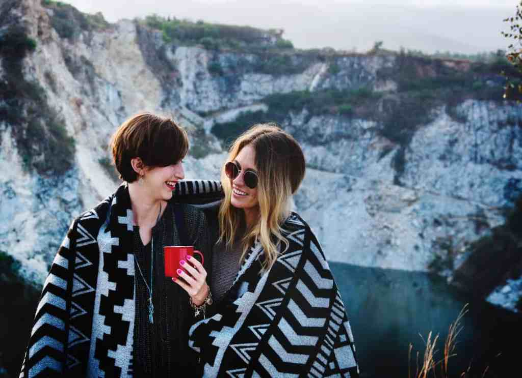 Two lesbian, same sex attracted people, share an intimate moment of love and heart connection over a cup of coffee