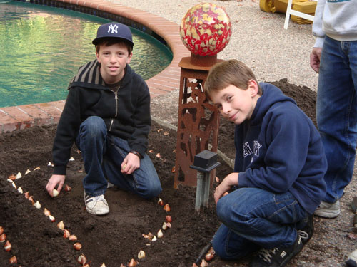 Nicholas and Dylan planting tulip bulbs