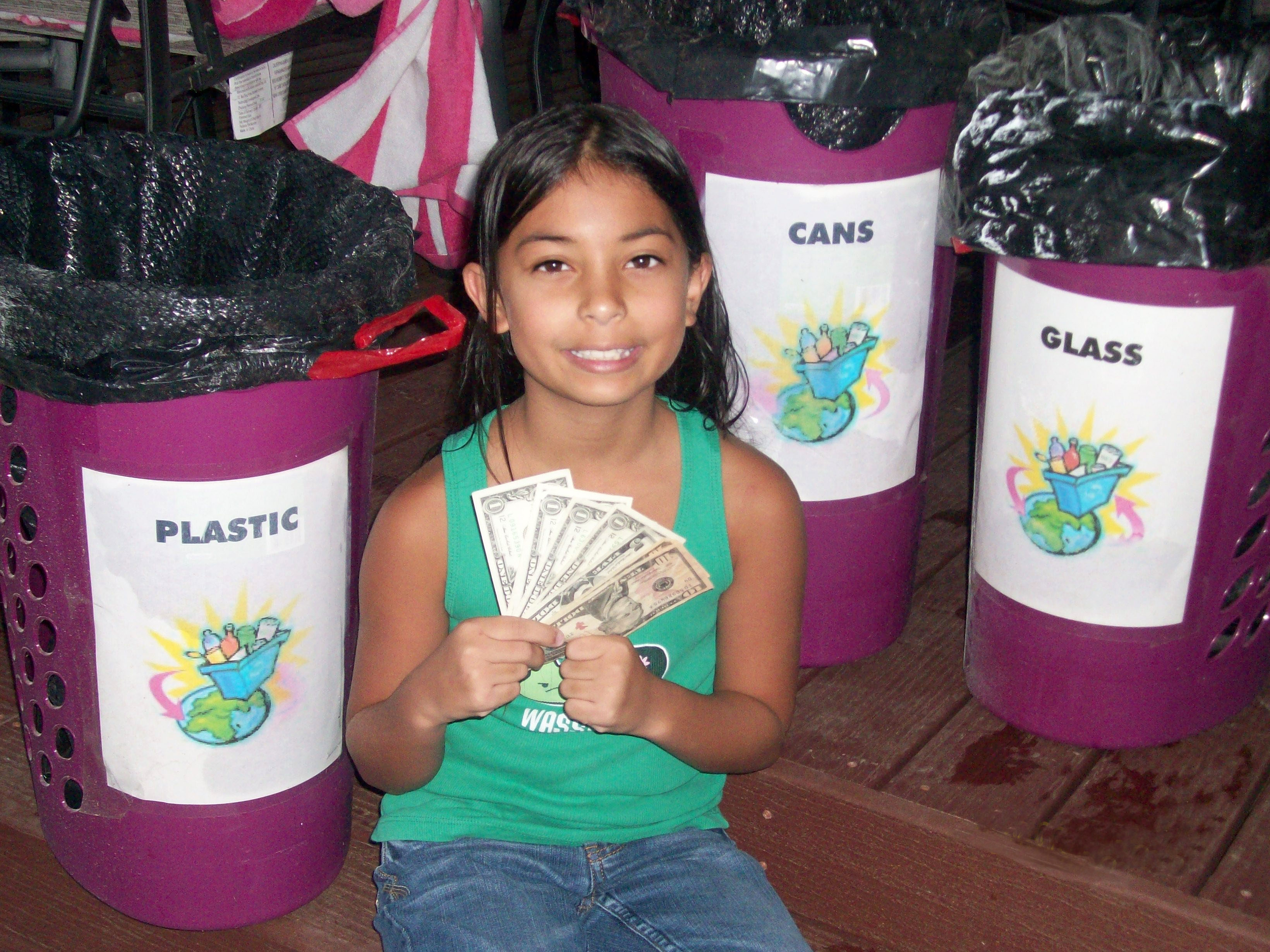 Kira Showing her Recycling Earnings