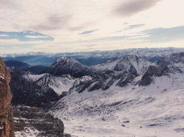 Zugspitze, Germany. After a gorgeous train ride up the mountain you exit the station only to find yourself at this beautiful vantage point.