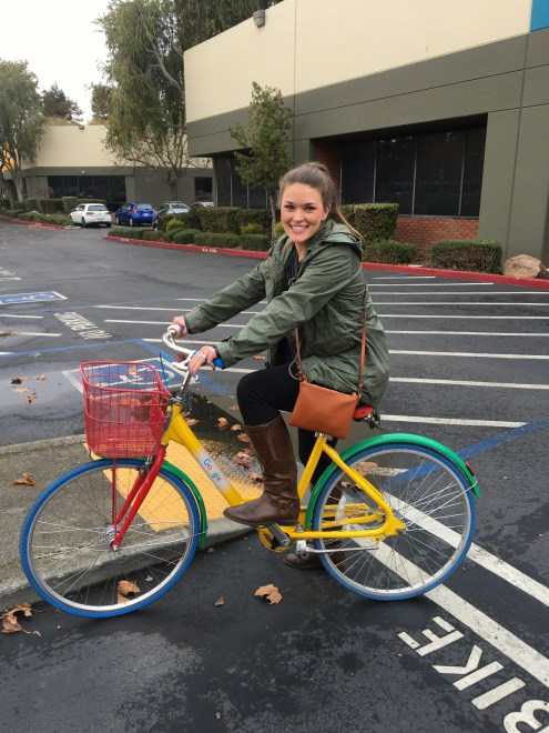 Lauryn riding a Google bike at Google