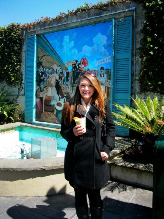 Lauryn holding a pina colada in New Orleans