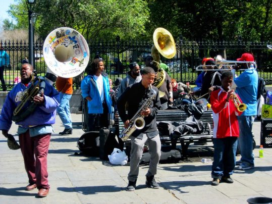 Musicians playing in front of St. Louis Cathedral in New Orleans