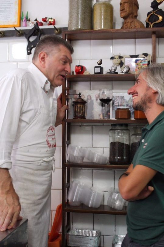 Dario and Bernardo chatting in the butcher shop in Tuscany