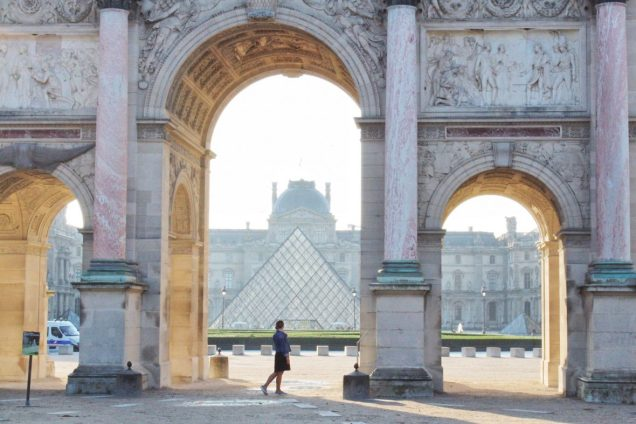 Standing in front of the Louvre Pyramid in Paris, France