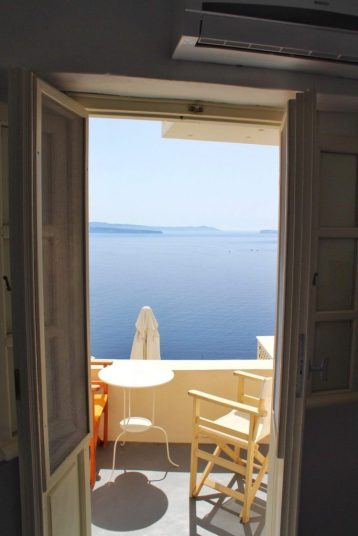 View from the door going out to our patio in our Airbnb in Santorini