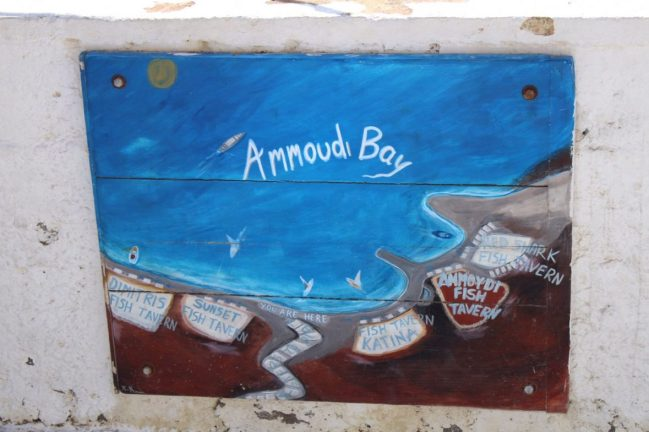 Amoudi Bay sign at the end of the path