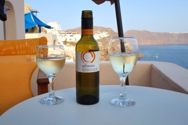 Drinking wine on the balcony of our Airbnb in Santorini