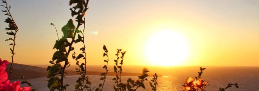 Sunset over the caldera in Oia Santorini