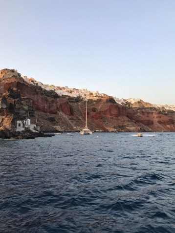 View of Oia Santorini from the water at sunset