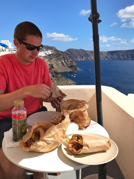 Eric and I eating lunch on the balcony of our Airbnb in Santorini