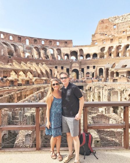 At the Colosseum in Rome, Italy wearing one of my favorite travel products: Naot Sandals