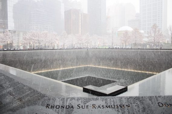 Snow at the 9/11 Memorial reflection pool - New York