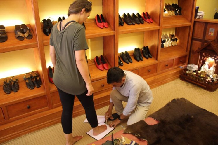 Getting fitted for shoes at Angkor Shoes Making in Siem Reap