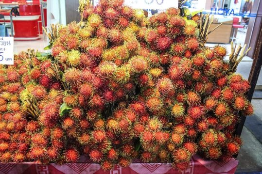 A pile of rambutans at the market in Chiang Mai