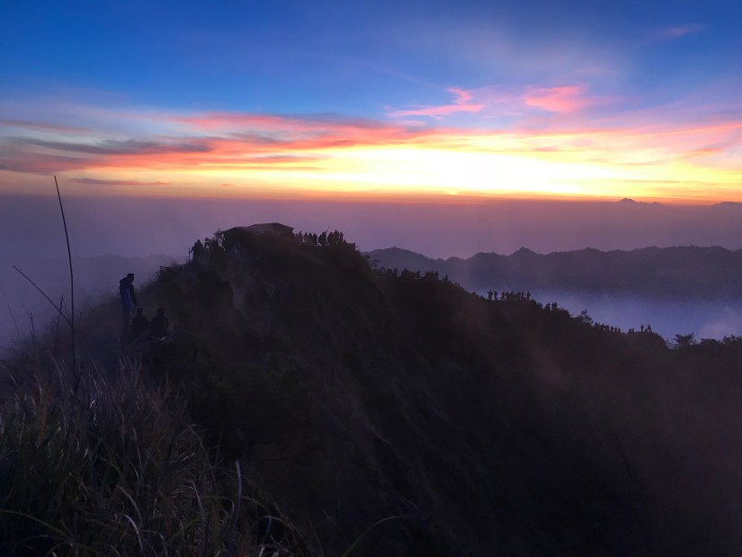 The vibrant colors of the sunrise on top of Mount Batur