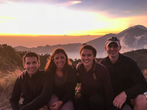 Lauryn, Eric, Kristi, and Kevin on top of Mount Batur with the sunrise in the background