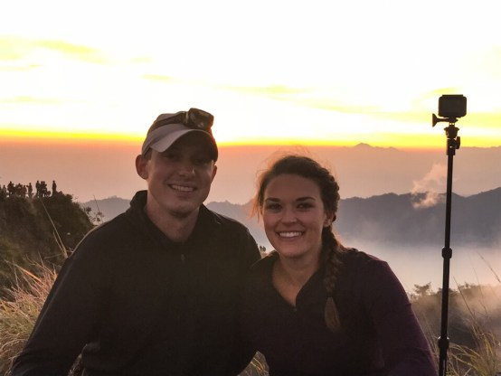 Eric and Lauryn on top of Mount Batur with the sunrise in the background