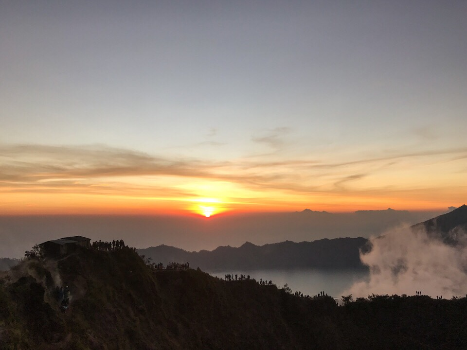 Sun starting to rise at the top of Mount Batur