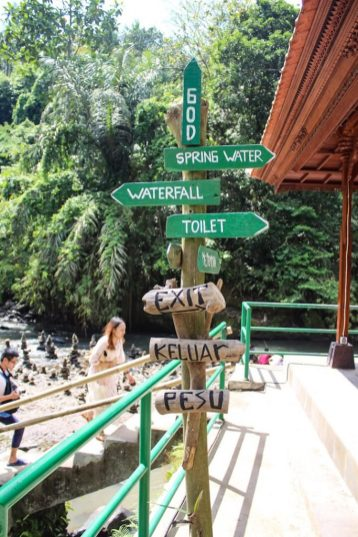 Sign at tegenungan waterfall ubud bali