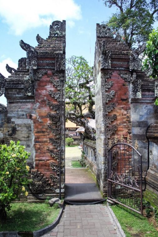 Standing with Margon Inside Batuan Temple Ubud Bali