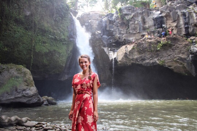 standing in front of tegenungan waterfall ubud bali